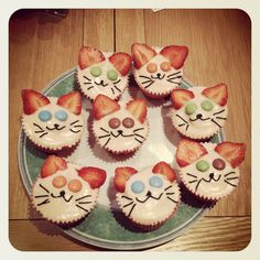 cat cakes :). Strawberries for ears?