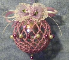 Irridescent ornament covered with a crocheted mesh cover and embellished with beads, flowers and ribbons. It is a standard 2 5/8 inch ornament that can be used year round or hung on your Christmas tree.$10.00