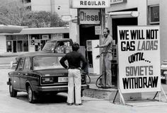 A driver of a Lada car can't get his tank refilled due to the Russian invasion of Afghanistan. Toronto 1984, pin by Paolo Marzioli