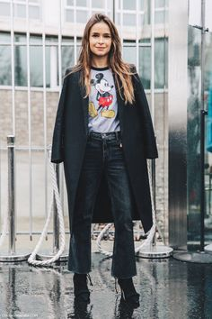 Duster coat, graphic Mickey Mouse tee, ankle jeans, ankle boots