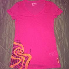 Pink reebok shirt -- never worn Light weight pink tshirt. Never worn, brand new! Reebok Tops Tees - Short Sleeve