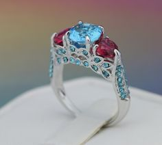 Really pretty.  Size: 6 -10 Gorgeous 3 Stone Blue CZ ring #145. Starting at $1