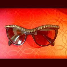 "Prada cat eye bling sunglasses Authentic Prada Cateye Sunglasses. Missing one of the ""diamond"" pieces in the front of the sunglasses. Otherwise in good condition. Prada Accessories Sunglasses"