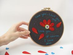 Love you...Love you not...Embroidered hoop hanging wall art. $35,00, via Etsy.