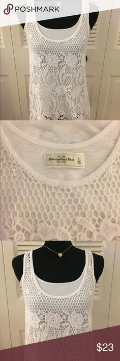 """Abercrombie & Fitch white embroidered tank. Abercrombie & Fitch gorgeous embroidered white long tank. Layered with a white tank to illustrate the embroidered details. Could also wear it as a swimsuit coverup. Pair with a cardigan for year long use. Bust 18"""" L 29.5"""" Abercrombie & Fitch Tops Tank Tops"""