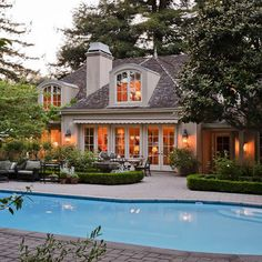 Lovely pool and outside area - love how the house opens up to the outside ...