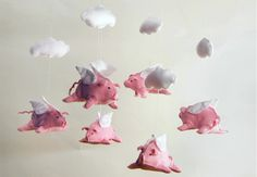 CUTE baby mobile.  I would decorate a nursery in flying pigs & clouds just so i could use this mobile.