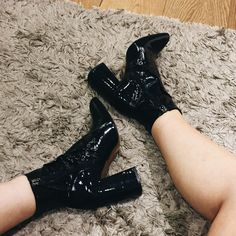 Step out in this season's must-have ankle boots. Pade from patent leather, they come with a shine finish and flared heel for a glamorous edge. #Topshop