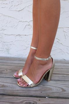 Gold heels with single ankle strap.   Heel Height is 3in