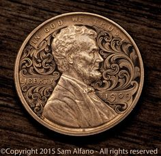 Sam Alfano engraved this 1909 penny, surrounding Abe Lincoln with a whorl of scrollwork. Metal Engraving Tools, Engraving Art, Hobo Nickel, Coin Art, Coin Ring, Coin Jewelry, Silver Work, Metal Crafts, Metal Art