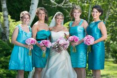 Turquoise dresses with bouquets in shades of pink peonies & roses.