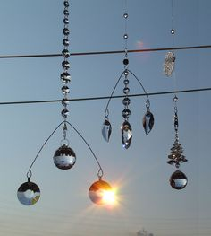 Suncatcher - Wikipedia Suncatchers, Cover Photos, Wind Chimes, Track Lighting, Ceiling Lights, Crystals, Image, Dream Catchers, Turning