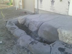 Some of Hazen's concrete work  -concrete made to look like rocks, this is a wheelchair ramp and curb