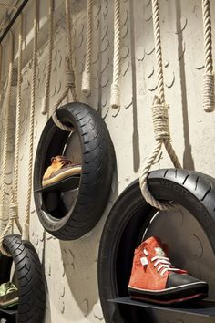 Cool display idea - old tires / Dom Arquitectura + Asa Studio