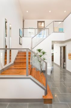 Sublime Wooden Stair Case Ideas in Staircase Contemporary design ideas with entry glass glass railing grey tile large
