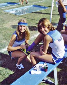 Cheryl Ladd gives Kristy McNichol a hand with her shoes at the Battle of the Network Stars.