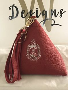 Delta Sigma Theta DST Sequined Leopard Zippered Tote Lightweight tote, great for the beach or on the go in true Diva style! Red leopard sequined front, zippered top closure, lined with I side slip pocket. Measures Handle drop is Ready to ship! Delta Sigma Theta Apparel, Delta Sorority, Sorority Gifts, Sorority Sisters, Delta Girl, Leather Tassel, Pebbled Leather, Couture, Swagg