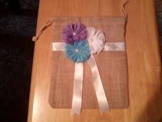 Burlap dollar dance bag embellished with lavender, sky blue and white shabby chiffon flowers with satin ribbon.