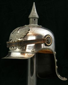 Prussian Cuirassier (mounted jagers) enlisted helmet. This lobstertail helmet worn by mounted heavy and light Prussian cavalry was first introduced in 1915. The silver plated iron helmet features a large Prussian frontplate (wappen) with the zinc Prussian eagle. The enlisted style leather chinstrap is secured to each side by a rosette plate with a kokarde with the German national colors on one side and the state colored black and white kokarde indicating Prussia on the other.
