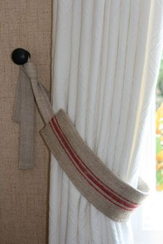 Curtain hangers from burlap/coffee sacks.
