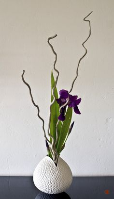 "Altar Vases: This is Ikebana Japanese style flower arranging - ""less is more"". We do not like the curly twigs, but the upward motion of the arrangement is very uplifting."