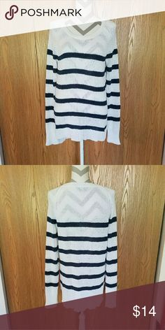 Long Navy Striped Sweater! White sweater with navy stripes. Cotton and polyester blend. Unique knit T-shirt type material. Slight high-low style. Length in the front is about 28 inches and length in the back is about 30 inches. Armpit to armpit is about 20 inches. Like new! Only Mine Sweaters Crew & Scoop Necks
