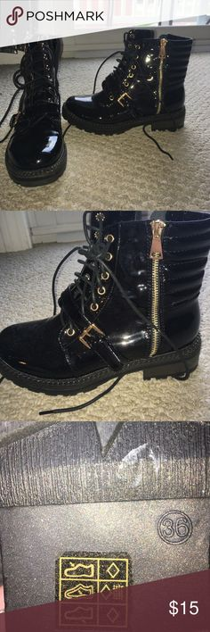 Shiny, black combat boots I bought these bad boys in Italy, but unfortunately they were too small. I normally wear a 7 and tried to guess the European size. The zipper and buckle are a copper color. Shoes Combat & Moto Boots