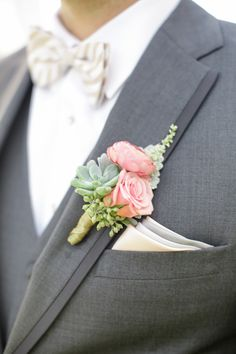 pink boutonniere with succulents