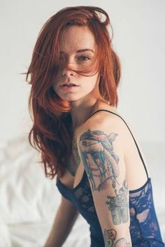 Beautiful Redhead and tattoos