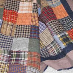 Quilt made from old men's plaid shirts;)