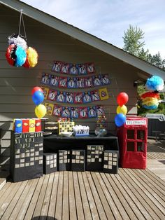 Super Hero Birthday Party ideas - I like the building and telephone booth.