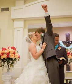 So fun! The groom threw his fist in the air after the big kiss. Click to view more from this traditional Nashville wedding with summery details! Bridal gown and bridal party attire from @lowsbridal. Image: Amy Hunter | The Pink Bride www.thepinkbride.com