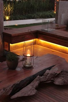 Lighting underneath the deck seating creates a nice candle-like glow outdoors.