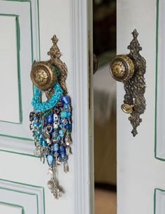Talismans are placed on door handles to bring good luck.