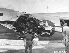 """Crews examine flak damage to B-17G Fortress at RAF Bassingbourn, Cambridgeshire, England, UK. Damage sustained on mission to Munich, Germany, Jul 6 1944. Note """"Mickey"""" pathfinder radar dome in place of ball turret. United States National Archives via D. Sheley ~"""