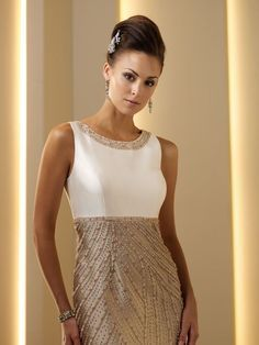 An elegant beaded ivory and gold mother of the bride dress via Wedding Dresses Mall