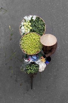 Standing amidthe bustling streets of Hanoi's Old Quarteris one of my fondest memories ofVietnam. Your senses are abuzz - and that's not just the Vietnamese coffee kicking in. The smells from street food and the sounds of vendors is awakening. And bicycle after bicycle, packed highwith