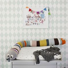 ferm LIVING Kids: Mr. Snake:http://www.fermliving.com/webshop/shop/all-products/mr--snake-cushion.aspx Harlequin Wallpaper Mint: http://www.fermliving.com/webshop/shop/all-products/harlequin-wallpaper-mint.aspx