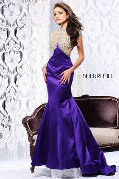 Olivia Culpo in an electric purple @Sherri Hill dress.