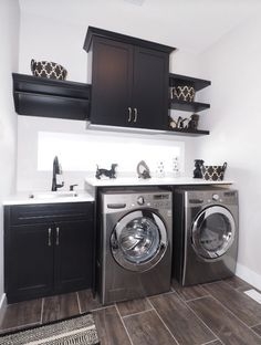 Laundry room cabinets, extra storage, shelves and hanging rod. It looks great but not sure about lint vs black cabinets!