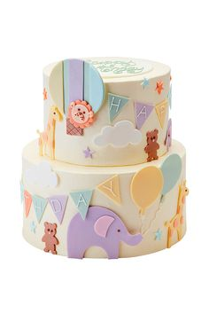 Baby Animal CakeCelebrate baby's first birthday with this jolly party cake featuring baby giraffes, lions, teddy bears and elephants, all playfully arranged amongst colourful bunting, pretty balloons, clouds and little stars. A 'Happy Birthday' message is