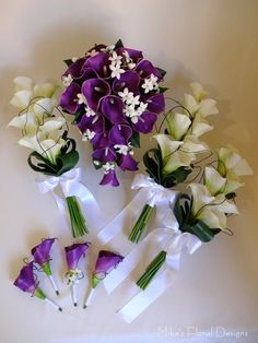 purple calla lily and stephanotis bouquet - This is it! cascade bouquet for bride. and love the bridesmaid bouquets different type of arrangement