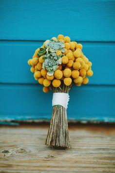 craspedia and succulent bouquet, photo by Brittany Esther http://ruffledblog.com/australian-yacht-club-wedding #flowers #weddingbouquet #billybuttons