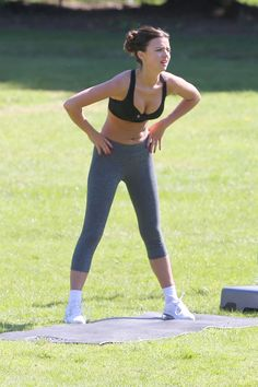 Lucy Mecklenburgh doing a workout in a London park, May 2013.