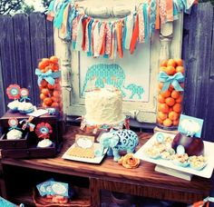 Aqua and orange is a possibility... I love the little pennant banner on the cake!