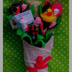 """Baby """"bouquet"""" - includes a wash cloth, onesie, pair of pants, a shirt, 4 pairs of socks, a receiving blanket and a rubber ducky - great shower idea!"""