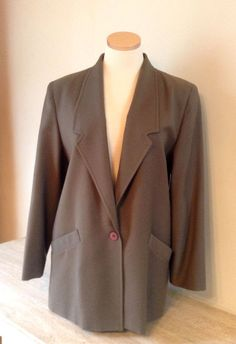 Vintage Wool Blazer for Women, Ladies 1980s Taupe Wool Blazer Jacket - Size 8  Classy vintage 1980s blazer for women signed Clichy. This blazer jacket is made of 100% wool in a greenish taupe color. It is fully lined in a reddish brown satin and has side pockets also lined. Made in Canada. Dry Cleaning only.  Size 8  Measurements taken with garment laid flat.  Shoulders: 44 cm (21.75 inches)  Bust: 55 cm (21.75 inches)  Waist: 54 cm (21.25 inches)  Length: 77 cm (30.5 inches)  Sleeves: 57.5…