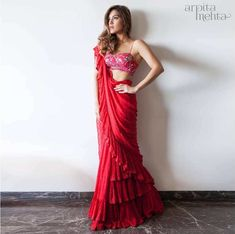 Red ruffles saree with pink embroidered saree blouse. #Frugal2Fab