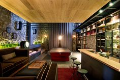 Sala de juegos - Bar: Cavas de estilo Ecléctico por Weber Arquitectos
