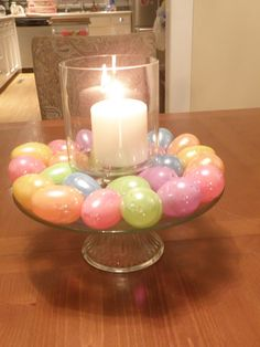 """My """"Martha Stewart"""" moment with faux Easter eggs, a cake plate, glass candle holder & candle.  All purchased at Wal-Mart."""